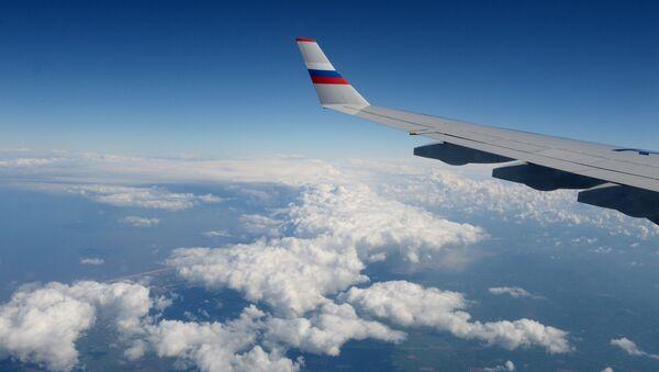 Вид из иллюминатора российского самолета во время полета - Sputnik Արմենիա