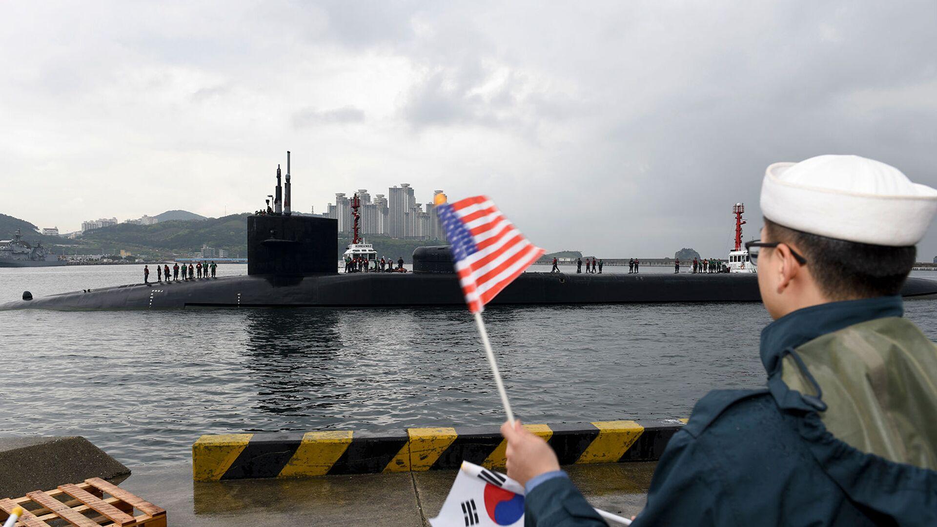 Подводная лодка с управляемыми ракетами класса Огайо USS Michigan прибывает в Пусан (24 апреля 2017). Южная Корея - Sputnik Армения, 1920, 20.09.2021