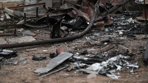 Поврежденный от обстрелов двор дома Эдика Степаняна в Гадруте - Sputnik Армения