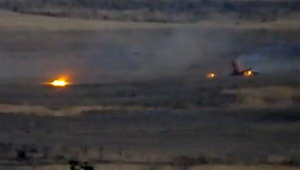 ВС Армении подбивают азербайджанский беспилотный летательный аппарат. Кадр из видео - Sputnik Արմենիա