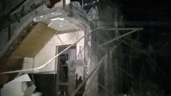 Обрушенное здание после ночных обстрелов (6 октября 2020). Степанакерт - Sputnik Արմենիա