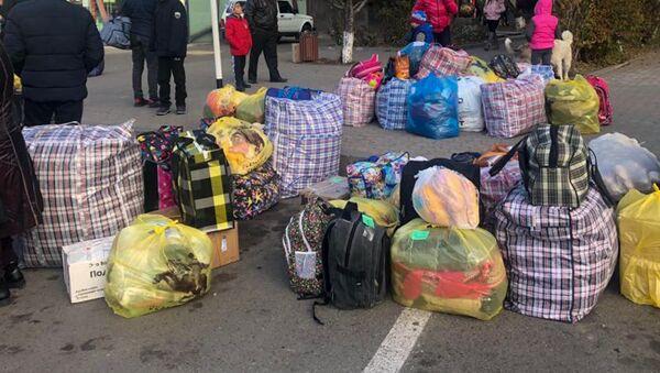 57 карабахцев, временно поселившихся в Гюмри, возвращаются на родину (23 ноября 2020). Гюмри - Sputnik Արմենիա