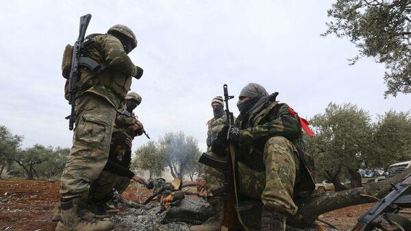 Поддерживаемые Турцией сирийские боевики готовятся отправиться на передовую в провинции Идлиб (11 февраля 2020). Сирия - Sputnik Армения