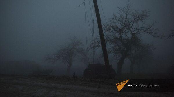 Трактор на одной из улиц в селе Тагавард Мартунинского района (11 декабря 2020). Карабах - Sputnik Արմենիա