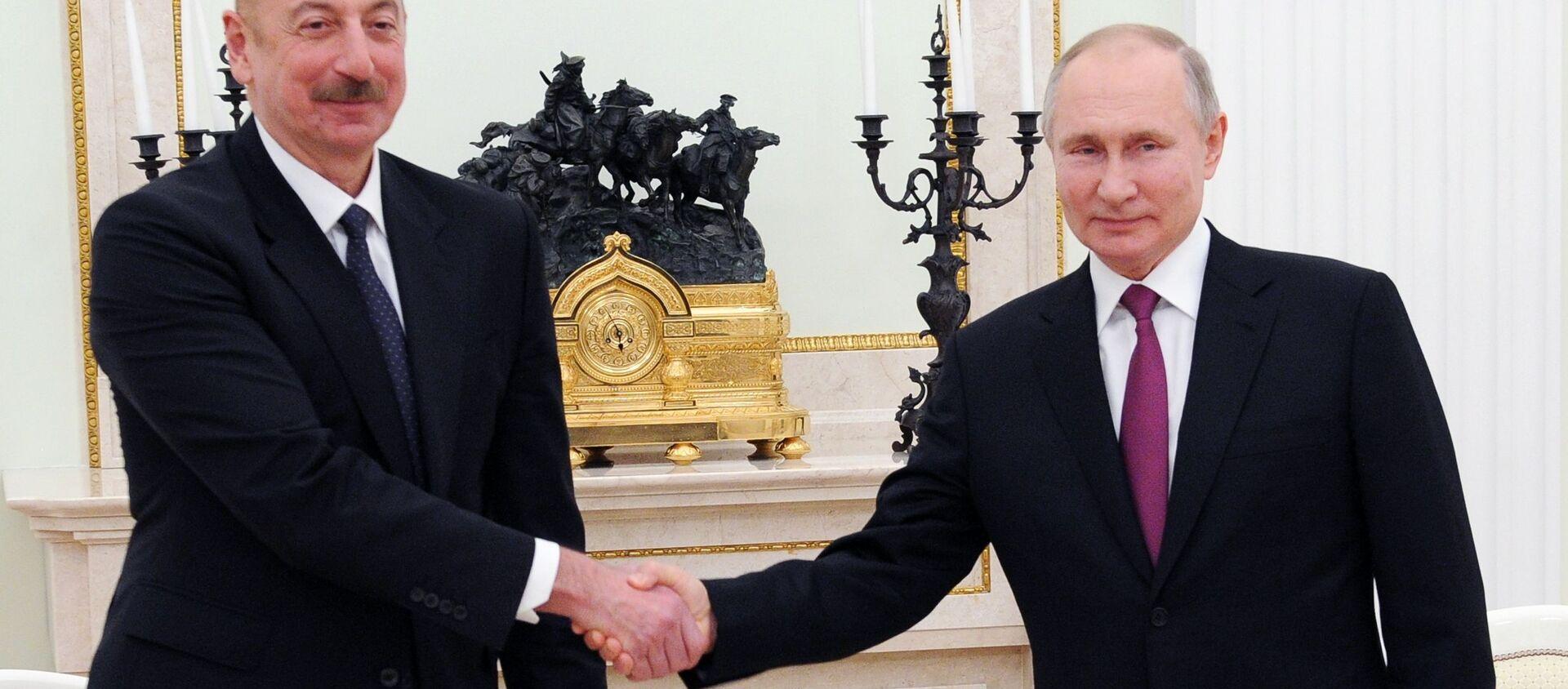 Президенты РФ и Азербайджана Владимир Путин и Ильхам Алиев (слева) во время переговоров (11 января 2021). Москва - Sputnik Արմենիա, 1920, 19.07.2021