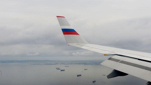 Вид из иллюминатора самолета российских авиалиний - Sputnik Армения