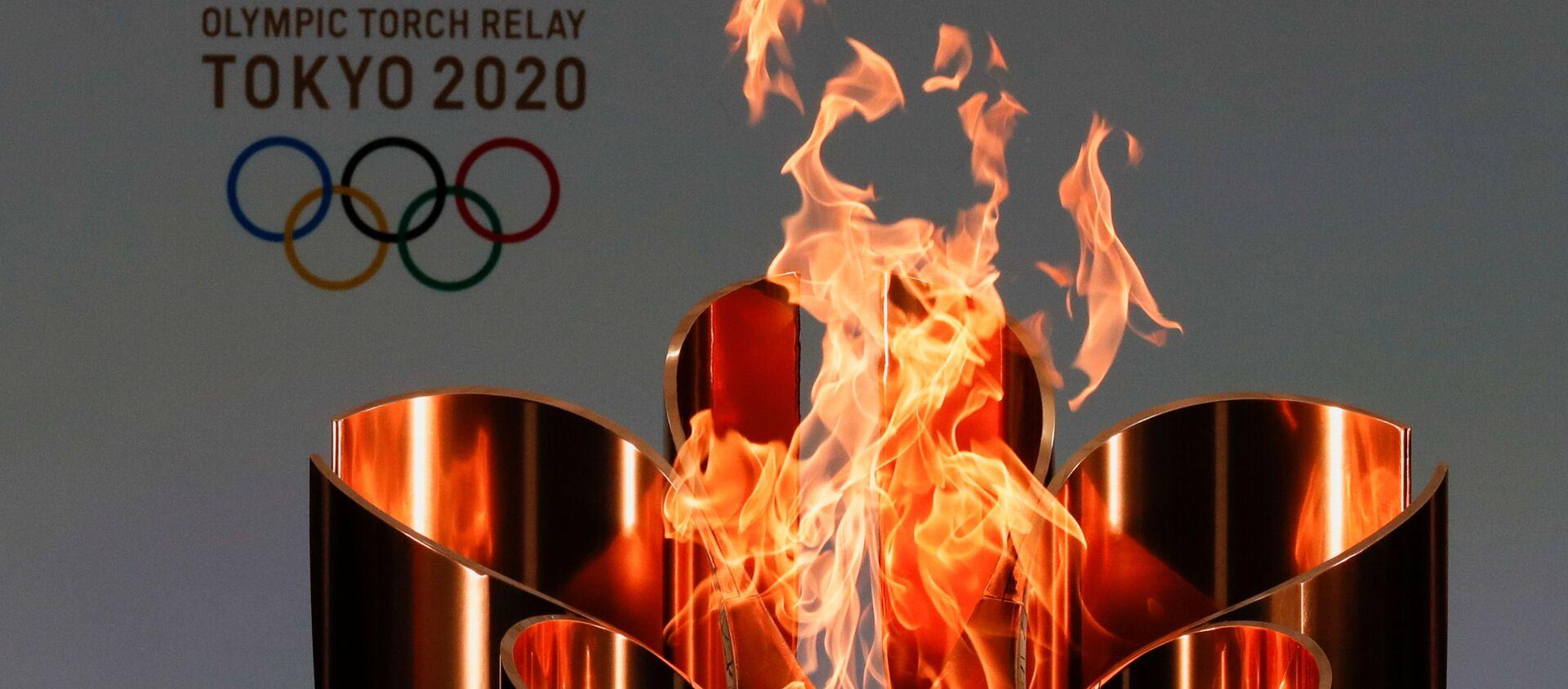 Олимпийский огонь во время эстафеты Олимпийского огня в Токио-2020 в префектуре Фукусима, Япония - Sputnik Արմենիա, 1920, 08.07.2021
