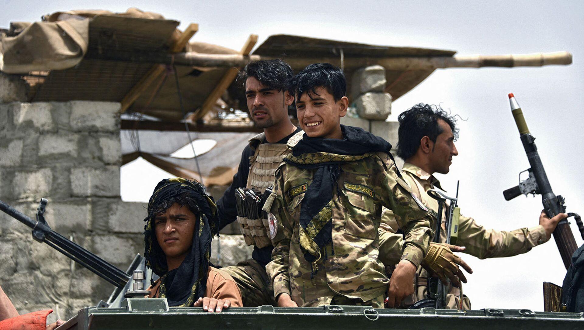 Афганские полицейские на блокпосту в районе Панджвай провинции Кандагар после захвата талибами района Кандагар (4 июля 2021). Афганистан - Sputnik Армения, 1920, 24.07.2021