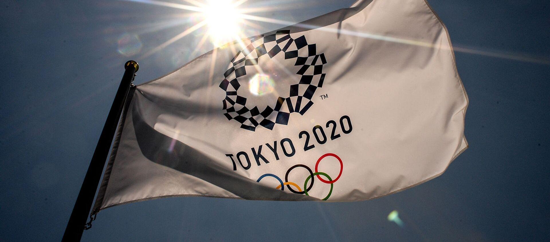 Флаг с символикой Олимпийских игр в Aomi Urban Sports Park в Токио - Sputnik Արմենիա, 1920, 22.07.2021