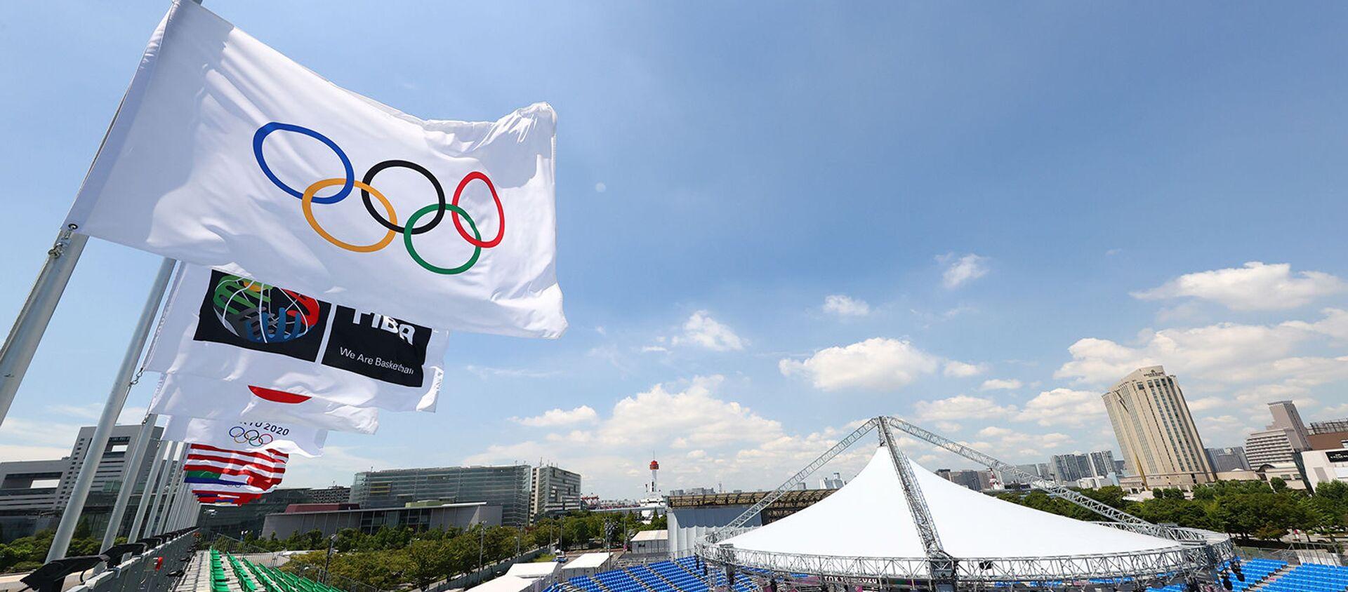 Олимпийские флаги на стадионе спортивного парка Аоми в Токио - Sputnik Արմենիա, 1920, 31.07.2021