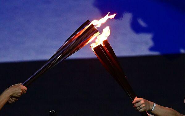 Օլիմպիական կրակի վառման արարողությունը՝ խաղերի բացման ժամանակ - Sputnik Արմենիա