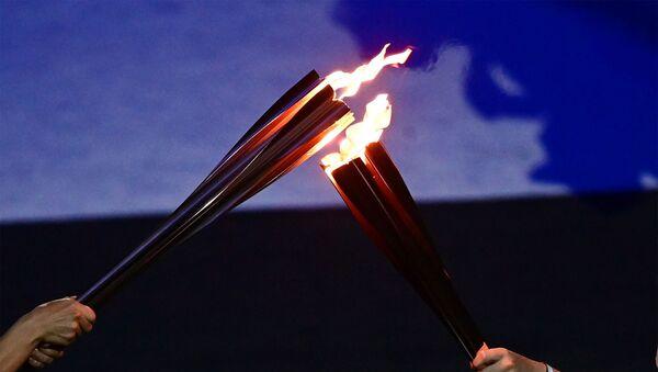 Церемония зажжения олимпийского огня во время открытия XXXII летних Олимпийских игр (23 июля 2021). Токио - Sputnik Армения