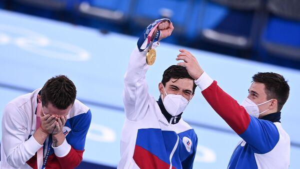 Давид Белявский, Артур Далалоян и Никита Нагорный (слева направо), завоевавшие золотые медали в командном многоборье среди мужчин на Олимпийских играх в Токио - Sputnik Արմենիա