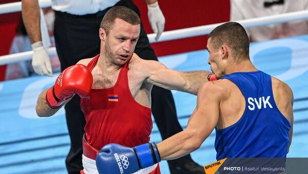 Арман Дарчинян во время поединка на Олимпийских играх в Токио (29 июля 2021). Япония - Sputnik Армения