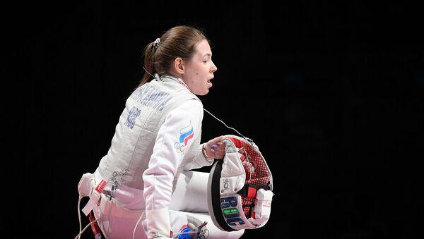 Российская спортсменка, член сборной России по фехтованию Марта Мартьянова в финальном поединке по фехтованию на рапирах во время командного первенства среди женщин на XXXII летних Олимпийских играх (29 июля 2021). Токио - Sputnik Армения