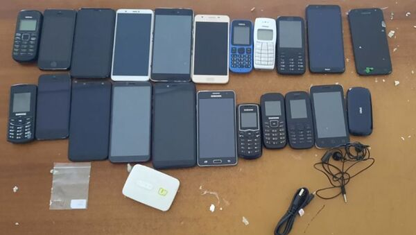 Конфискованная партия контрабандных мобильных телефонов - Sputnik Արմենիա