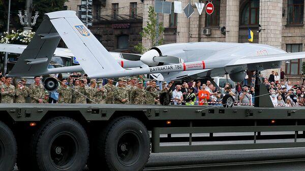 Беспилотный летательный аппарат Bayraktar на репетиции военного парада в честь Дня независимости Украины (18 августа 2021). Киев - Sputnik Армения