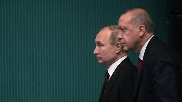Президенты РФ и Турции Владимир Путин и Реджеп Тайип Эрдоган на церемонии запуска начала строительства первого энергоблока атомной электростанции Аккую (3 апреля 2018). Анкара, Турция - Sputnik Армения