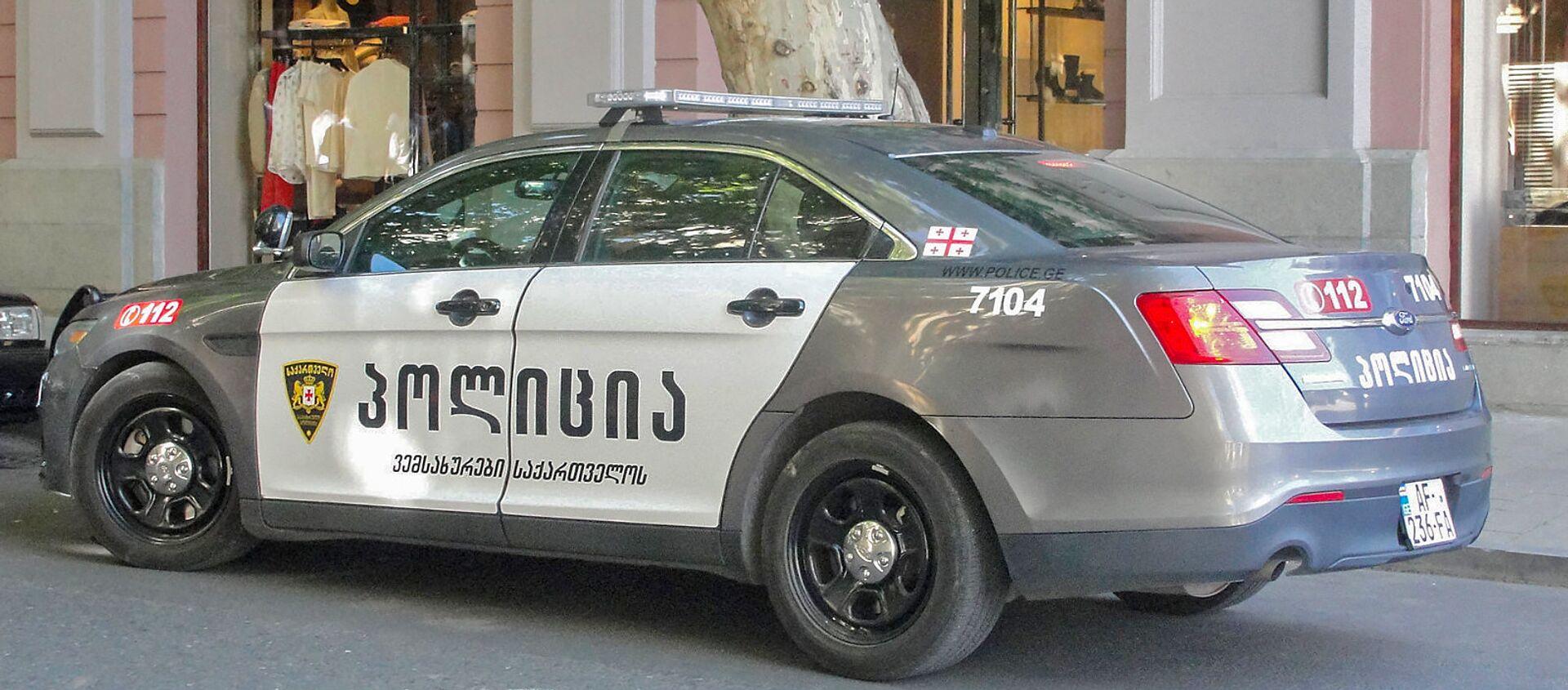 Полицейский автомобиль в Тбилиси - Sputnik Армения, 1920, 13.02.2021