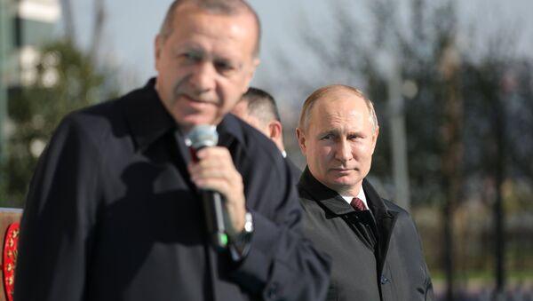 Президенты России и Турции Владимир Путин и Реджеп Тайип Эрдоган на церемонии запуска строительства первого энергоблока атомной электростанции Аккую (3 апреля 2018). Анкара - Sputnik Армения