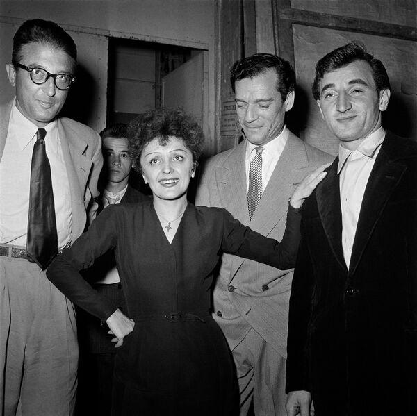 Երգչուհի Էդիթ Պիաֆը, կոմպոզիտոր Միշել Էմերը, դերասան Էդդի Կոնստանտինը և Շառլ Ազնավուրը. 1950 թ. - Sputnik Արմենիա