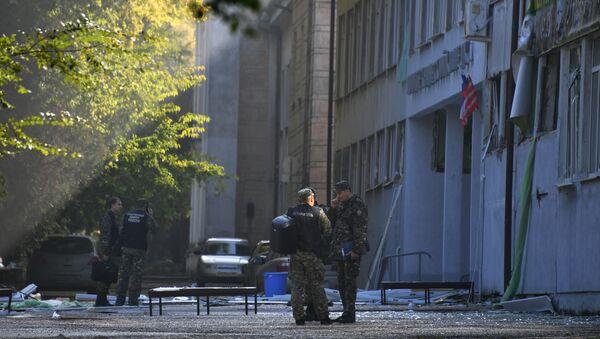 Сотрудники правоохранительных органов у здания Керченского политехнического колледжа (18 октября 2018). Керчь - Sputnik Армения