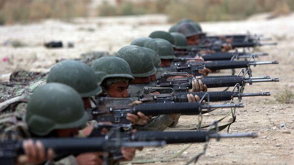 Солдаты афганской национальной армии на учениях огневой подготовки в афганской военной академии (31 октября 2018). Кабул - Sputnik Армения