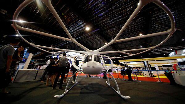 Воздушное такси немецкой компании Volocopter на выставке Rotorcraft Asia (11 апреля 2019). Сингапур - Sputnik Արմենիա