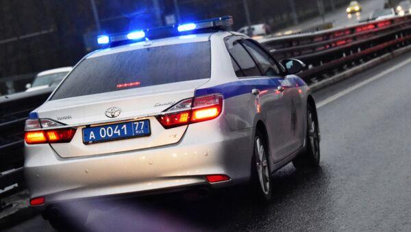 Автомобиль полиции на дороге в Москве.  - Sputnik Արմենիա