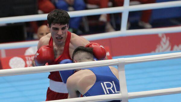 Поединок 1/8 финала по боксу среди мужчин в весовой категории до 64 кг между Ованнесом Бачковым (Армения) и Джеймсом Макгиверном (Ирландия) (25 июня 2019). Минск - Sputnik Армения