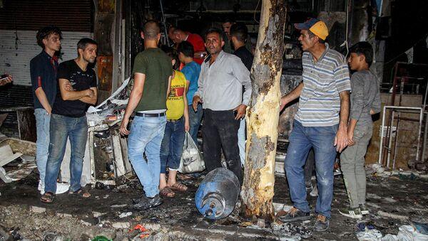 Последствия ракетно-артиллерийского обстрела в жилом районе в Алеппо (22 июля 2019). Сирия - Sputnik Армения