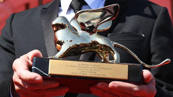 Статуэтка Золотой лев Венецианского международного кинофестиваля - Sputnik Армения