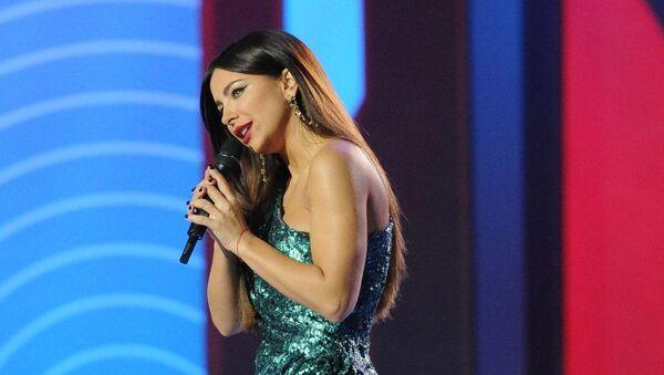 Певица Ани Лорак во время праздничного шоу модельера Валентина Юдашкина (9 марта 2017). Москвa - Sputnik Армения