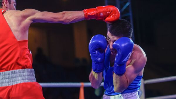 Артур Шахпазян и Артур Базеян в финале чемпионата по боксу Золотые перчатки (18 декабря 2019). Еревaн - Sputnik Армения