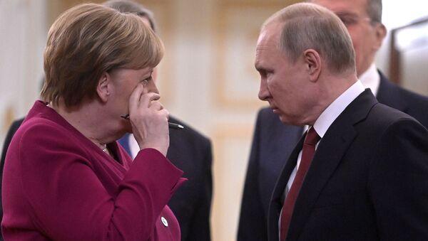 Президент России Владимир Путин и федеральный канцлер Германии Ангела Меркель перед совместной пресс-конференцией по итогам встречи (11 января 2020). Москвa - Sputnik Армения