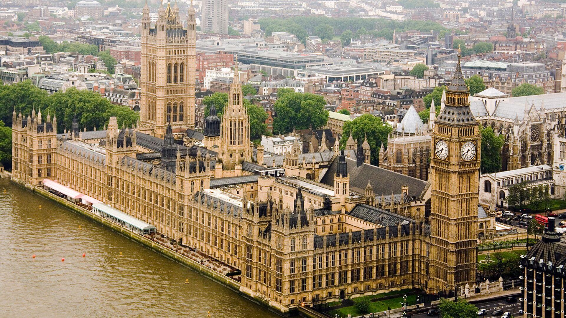 Здание британского Парламента (Вестминстерский дворец) на реке Темза - Sputnik Армения, 1920, 28.09.2021