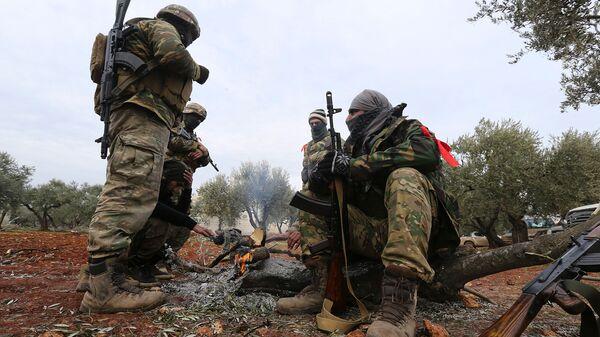 Поддерживаемые Турцией сирийские боевики готовятся выйти на линию фронта в провинции Идлиб (11 февраля 2020). Сирия - Sputnik Армения