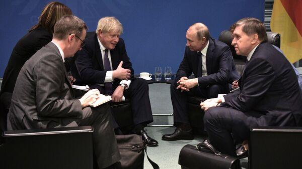 Президент РФ Владимир Путин и премьер-министр Великобритании Борис Джонсон (19 января 2020). Берлин - Sputnik Армения