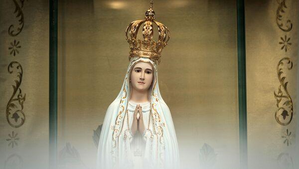 Статуя Богоматери Фатимской во время Столетней мессы, посвященной явлению Девы Марии, в часовне призраков (13 мая 2017). Рио-де-Жанейро - Sputnik Արմենիա