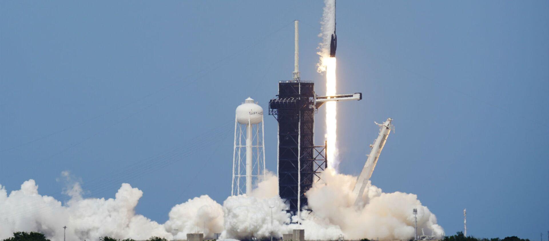 Kапсулa экипажа «Crew Dragon» с астронавтами Дугом Херли и Бобом Бенкеном в рамках программы SpaceX стартует в Космическом центре Кеннеди на мысе Канаверал (30 мая 2020). Флорида - Sputnik Արմենիա, 1920, 09.07.2021