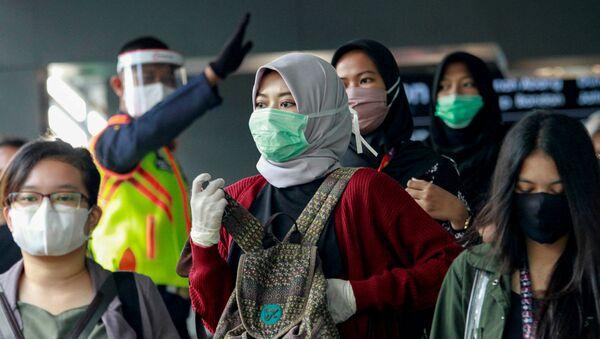 Люди в защитных масках (9 июня 2020). Джакарта, Индонезия - Sputnik Армения