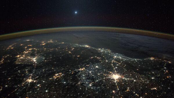 Снимок планеты, полученное с Международной космической станции. Архивное фото. - Sputnik Армения
